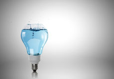 Light bulb with water Royalty Free Stock Images