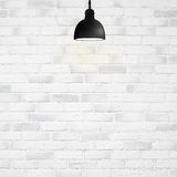 Light bulb on white wall Royalty Free Stock Photography