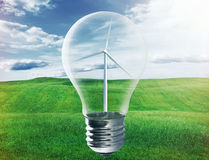 Light bulb with wind turbine inside Royalty Free Stock Image