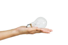 Light bulb in woman hand on white background Royalty Free Stock Photography