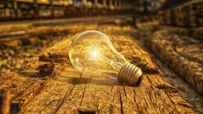 Light bulb on wood background Royalty Free Stock Photography