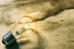 Light bulb on a wood table Stock Image