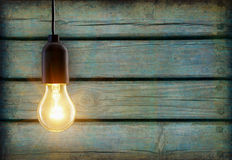Light bulb on wooden background Stock Images