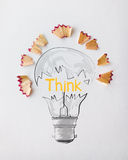 Light bulb word design THINK with pencil saw dust Stock Photo