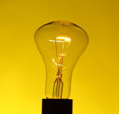 Light bulb on yellow Royalty Free Stock Photos