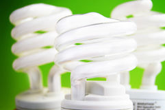 Light bulbs. Energy efficient light bulbs on green background stock photo
