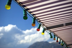 Light bulbs. Colored light bulbs all in a row, on a cruising ship royalty free stock photo