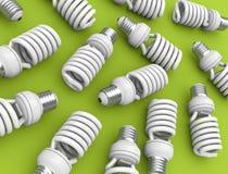 Light Bulbs. Energy efficient light bulbs on green plane. 3D rendered illustration Stock Photos