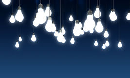 Light bulbs. Hanging glowing light bulbs on blue background Stock Photos