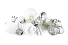 Light bulbs. Mixed heap of light bulbs with filament bulbs and energy salving lamps on white Stock Photography
