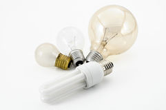 Light bulbs. Old light bulds and one energy saving bulb Royalty Free Stock Image