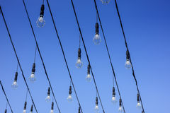 Light bulbs against the blue sky Royalty Free Stock Image