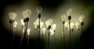 Light Bulbs Aiming Skyward With Eerie Glow Royalty Free Stock Photography