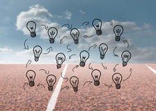 Light bulbs with arrows over running track Stock Images