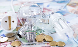 Light Bulbs on banknotes Stock Images
