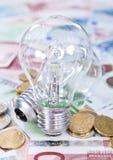Light Bulbs on banknotes Stock Photo