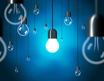 Light bulbs on blue background, horizontally Stock Image