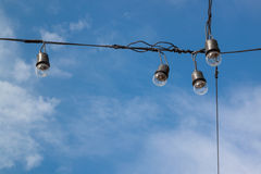 Light bulbs on blue sky  background Royalty Free Stock Images
