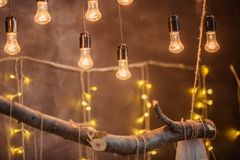 Light bulbs on a brown surface background. royalty free stock photography