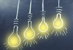 Light bulbs on chalkboard vector illustration
