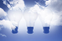 Light Bulbs and Clouds Stock Images