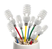 Light Bulbs with colored cables growing in a pot. New Bright Ideas - Fluorescent Light Bulbs attached to a colored network cables growing in a pot on a white Stock Photo
