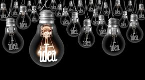 Light Bulbs with Idea Concept. Large group of shining and dimmed light bulbs with fibers in a shape of Idea words isolated on black background; concept of vector illustration