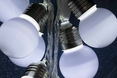 Light bulbs on dark blue background Royalty Free Stock Image