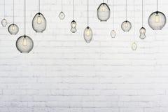 Light bulbs in an empty loft interior Stock Photo