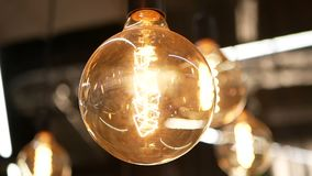 Light macro lamp decoration. Light bulbs garland close up. Electric bulb stock video