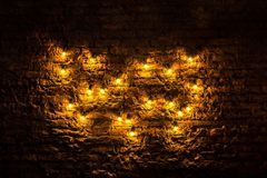 Light bulbs glowing background. Brick wall with light bulbs glowing background Stock Photo