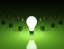Light bulbs on green background Royalty Free Stock Photo