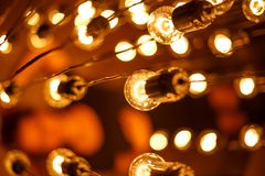Light bulbs hang and glow soft focus.  stock images