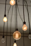 Light Bulbs hanging on the ceiling. Some on and some off Stock Photography