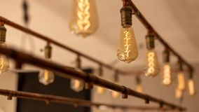 Light bulbs hanging from the ceiling. Vintage style Stock Image