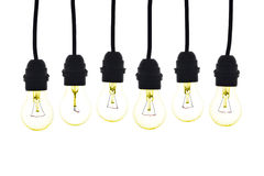 Light bulbs hanging colored yellow on white Stock Image