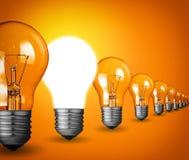 Light bulbs. Idea concept with light bulbs on orange background Stock Photography