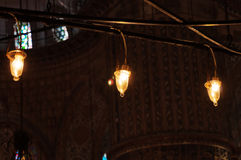 Light bulbs in iterior of Blue Mosque in Istanbul. ISTANBUL, TURKEY, DEC 4, 2014: Light bulbs in iterior of Blue Mosque. The Sultan Ahmed Mosque is a historic Stock Photo