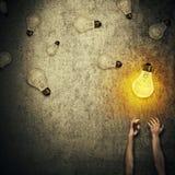 Light bulbs juggling Royalty Free Stock Image