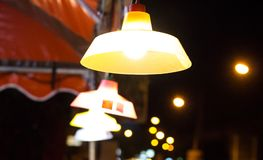 Light bulbs and lamps at night stock photo
