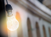 Light bulbs with light effect & x28;yellow and orange Lens Flare ligh Stock Photo