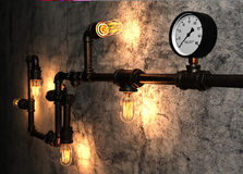 Light bulbs and metal pipes on the old cement wall. Represent industrial atmosphere Stock Image
