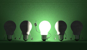 Light bulbs, moment of insight on green Stock Images