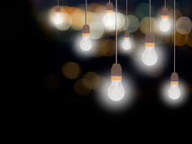 Light bulbs, old style, with bokeh background and copyspace. Royalty Free Stock Photos