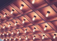 Light Bulbs Pattern wooden Ceiling Interior decoration. Retro style Architecture details Stock Photo
