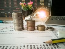 Light bulbs are placed in business documents and financial accounting concepts. royalty free stock image