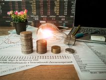 Light bulbs are placed in business documents and financial accounting concepts. stock photography
