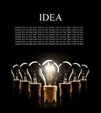 Light bulbs in row with single one shinning Royalty Free Stock Photo