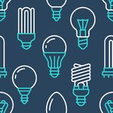 Light bulbs seamless pattern with flat line icons. Led lamps types, fluorescent, filament, halogen, diode and other. Illumination. Modern dark blue background Royalty Free Stock Photo