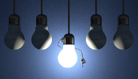 Light bulbs in sockets, moment of insight on blue Stock Photo